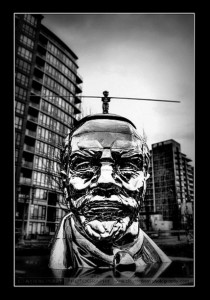 Miss Mao Trying to Poise Herself at the Top of Lenin's Head. Photo by Clayton Perry_02