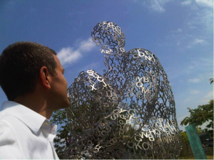 "The author and Jaume Plensa's ""Overflow IV"" Graciously loaned by the Vancouver Biennale"