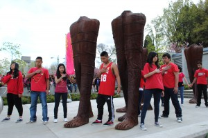 Magdalena Abakanowicz. WALKING FIGURES at Cambie and Broadway in Vancouver. 2014 - 2016 exhibition. students from Charles Tupper school. Photo by LAY TUAN TAN 0517